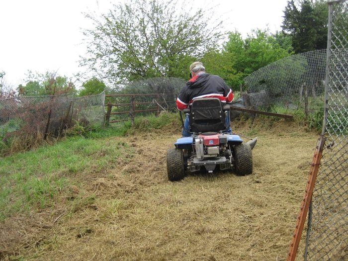 Papa mowing garden